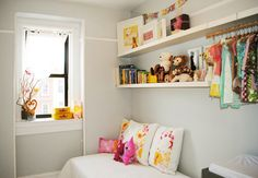love the shelves with he little hanging clothes space. Over Emma's space ? Bar back further...maybe short curtain in front ?