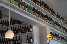 Maybe just do something like this in the Man Cave with all our neat beer bottles instead of trying to be crafty. We wouldn't have THIS many, but maybe a shelf over the door or behind the bar.