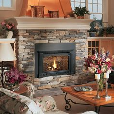 Fireplace Faces stacked stone fireplace but with a dark cherry wood mantle! | diy