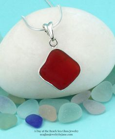 Ultra rare, cherry red sea glass, bezel set in sterling silver. Sea glass is genuine, beach found and unaltered. Sterling silver necklace. A treasure to gift or own!