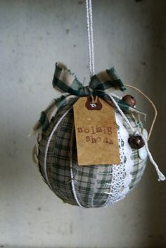 "Irish rag ball ornament - tag translation is ""Happy Christmas"""