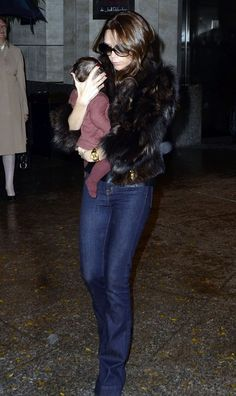 Victoria Beckham. JBRAND jeans. Accessorized with darling baby girl. Love Love!