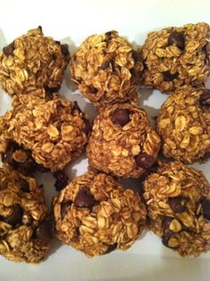 Breakfast Cookies    Preheat: oven to 350 degrees  Mix:  2 cups rolled oats 1 cup apple sauce 1 tablespoon almond butter 2 tablespoon flax meal 1 teaspoon baking soda 1 teaspoon vanilla 1 tablespoon pure agave nectar 1/2 cup slivers of dark chocolate from an 85% chocolate bar Dash of cinnamon