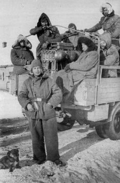 Squad leader Uscha Taisto Kuuri with his men and his new puppy. They are on the Eastern Front at The Kalmyk steppe, January 9, 1943.