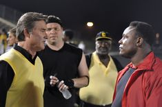 """""""Touchback"""" movie still, 2011. L to R: Kurt Russell, Barry Sanders. PLOT: A man (Brian Presley) looks back 15 years to the injury that ended his career as a promising high-school football player. This no-name movie was able to get Russell, Sanders, Christine Lahti, and Melanie Lynskey as co-stars. Thanks to limited distribution, it only earned $204,000 at the box office. Football Movies, High School Football Player, Football Players, Christine Lahti, Kurt Russell, Looking Back, Box Office, Stars, Sterne"""