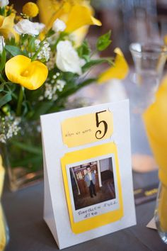 the sweetest table number idea ever