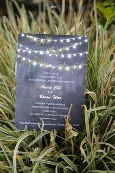 Modern wedding invitation idea - chalkboard-style wedding invitations with string light + greenery motif {Elizabeth Burgi Photography}