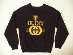 Gucci Rappers like Eric B. and Rakim loved Gucci. Who could forget how everyone went apeshit over Gucci sweatshirts too? Good thing Harlem's own Dapper Dan was busy finding the illest fabrics and putting in countless hours of work to make sure hip-hop's finest stayed looking fly.