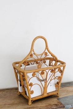 """We found this sweet rattan magazine rack at a Southern California flea market. It's the prettiest place to stash all those magazines you just can't stand to part with. Dimensions: 21"""" high, 18"""" wide, 11"""" deep"""
