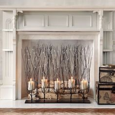 Fedora Candleholder - Grandin Road. This reminds me of our Michael Aram candlelit wall sconces. Beautiful!!
