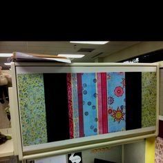 Scrap book paper. Mounted on cardboard. Great pretty wall panels for the office cube.