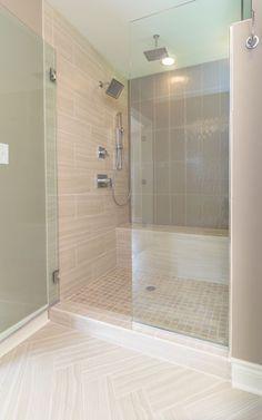 Master Shower designed by KHL Design Studio. Herringbone tile floor, square mosaic, glass doors.