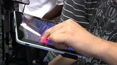 Students with autism at a New York school are using iPads as their instruments to perform in a band....