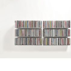 Connaissez-vous le meilleur système pour ranger vos CD et vos DVD?TEEbooks présente les étagères range-CD ou range-DVD simples, légères, économiques et invisibles.Vous pouvez composer votre système range-CD ou range-DVD, modulable...