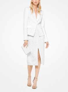 Sharply tailored from double crepe-sable, this blazer is embroidered with sequins and beads in a tonal floral motif. Pair it with the matching skirt for an ultra-luxe take on suiting. Michael Kors Collection, Floral Motif, Peplum Dress, Sequins, Blazer, Elegant, Skirts, Beads, Winter 2017