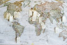 Wedding guest book idea for the wanderlusting couple: Have guests pin a note on a city they've traveled to