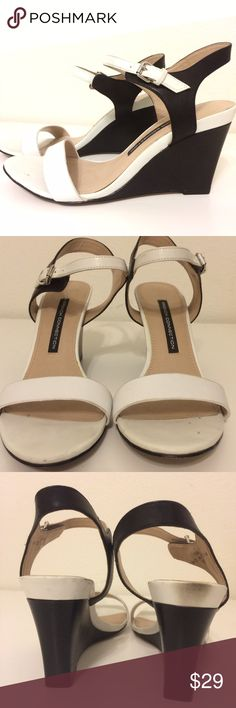 "French Connection black white wedge sandals sz 39 These French Connection wedges are black and white. They are in excellent condition, the right shoe has a black scuff on the back. They fit a 8.5 best! About 3"" tall. French Connection Shoes Wedges"