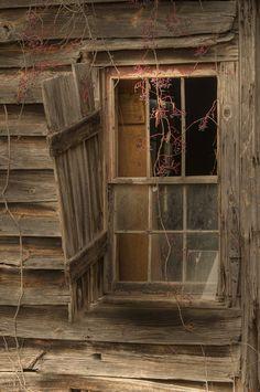 Open window in abandoned shack