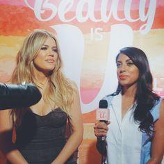 Aliya-Jasmine Sovani. Aliya Jasmine Reporter Style TV Fashion. blue dress shirt. sleevelss. Khloe Kardashian.