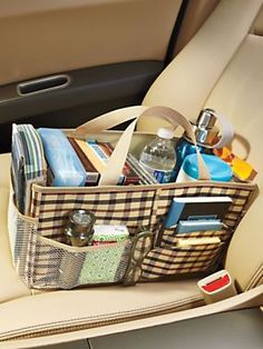 Keep your car tidy by organizing tissues, maps, CD's, snacks, sunglasses, and everything that always seems to pile up! | Solutions.com #OrganizingIdea #CarOrganizer