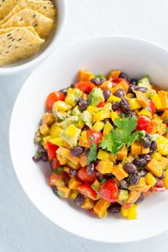 Sweet Potato Black Bean Avocado Salsa – healthy and delicious with beautiful color and bright, zesty flavor. This is not your average salsa! Sin Gluten, Delicious Vegan Recipes, Healthy Recipes, Vegetarian Recipes, Salsa, Fish And Chicken, Salad With Sweet Potato, Vegan Appetizers, Avocado Recipes