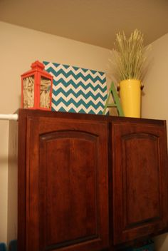 DIY chevron canvas..cool look for laundry room decor with the clothes pins in the lantern