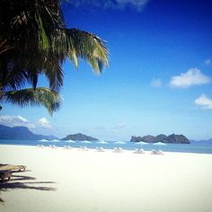 Escape to the mile-long beach and soak up the tropical sun in Langkawi!