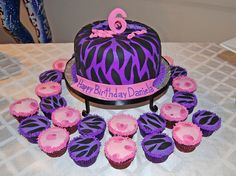Purple Zebra and Pink Cheetah Cake and Cupcakes for a 6 Birthday by Simply Sweets, via Flickr