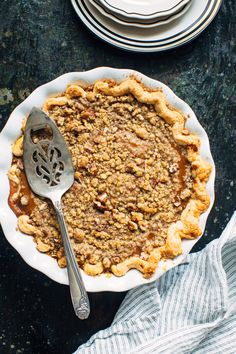 This Bourbon Pumpkin Pie with Pecan Crumble is an exciting addition to any Thanksgiving dessert table.