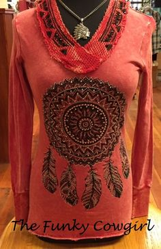 Black and ab stones on this raglan detailed top. www.thefunkycowgirl.com
