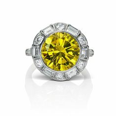 yellow round brilliant cut diamond with halo baguette and oval small stone setting  :O