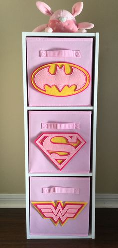 Girl Power! Perfect for your Superhero Nursery or girls bedroom! Pink Superhero Logo Bin Set available at Sew Freakin' Awesome on Etsy.