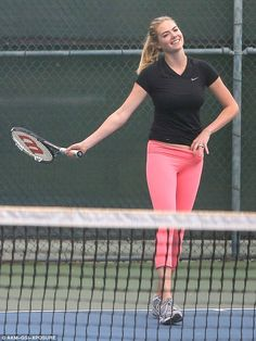 Model figure: Kate Upton enjoyed a game of tennis on Wednesday in Santa Monica turning heads in bright pink leggings and a form-fitting black shirt