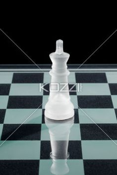 white chess queen. - Close-up image of white chess queen on chess board.