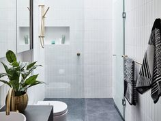 Make your narrow space work harder with a practical design and a smart layout. This bathroom features all the necessities of a modern… Reece Bathroom, Grey Bathroom Tiles, Bathroom Tile Designs, Bathroom Design Small, Bathroom Layout, Bathroom Interior Design, Grey Tiles, Bathroom Ideas, Bathroom Cost