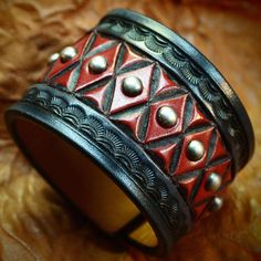 This leather cuff bracelet in Black and red hand dyed leather uses natural american veg-tan leather that is lined in smooth calfskin. It is Hand Leather Stamps, Leather Art, Custom Leather, Leather Cuffs, Leather Belts, Leather Tooling, Leather Jewelry, Leather Wallet, Tan Leather