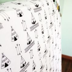 Fitted crib sheet by Aprilderek on Etsy. Teepees and arrows print- perfect for tribal themed nursery.