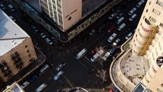 A static daytime timelaspe from the Ansteys building shooting down onto a busy street crossing between Jeppe street and Joubert street in the city (Johannesburg, Gauteng, South Africa) Busy Street, City Scene, Hd Video, Stock Footage, South Africa, Building, Travel, Viajes, Buildings