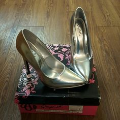 Silver heels --- will take offers!! Never been worn, still in the box Qupid Shoes Heels