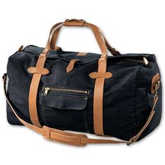 Filson's denim duffle bag; featuring Japanese selvage denim and natural color leather straps.
