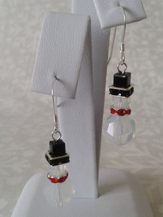 Christmas Sweet snowmen earrings made using Swarovski white opal crystals with silver plated red rhinestone spacers. All other components are sterling