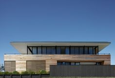 This house on the south coast of New South Wales was designed as one of a pair of modern beach houses occupying a greenfield site overlooking beautiful Gerringong beach.  The site is part of a new land release on the edge of a sleepy coastal town. Fro