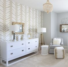 Neutral nursery with a wallpaper feature wall. White gray and cream comes together and makes peaceful sophisticated nursery. via Lucy and Company. Feature Wall Living Room, Living Room Decor, Bedroom Wallpaper Feature Wall, Wall Wallpaper, Disney Wallpaper, Wallpaper Quotes, Wallpaper Backgrounds, Iphone Wallpaper, Baby Room Neutral