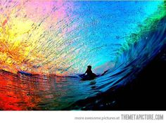 Photo of the sunset through a wave.