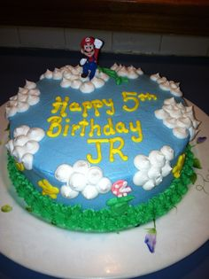 Super Mario cake.   Buttercream only!  Used the viva paper towel method to smooth out the buttercream