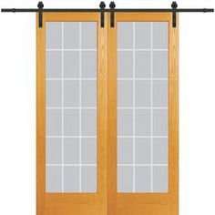 MMI DOOR Unfinished Pine Veneer Barn Door Hardware Included (Common: x Actual: x at Lowe's. MMI Door Interior French Barn Doors come with tempered glass for extra strength and safety. Each individual pane of glass contains a 1 in. Doors, Front Doors With Windows, Lowes Home Improvements, Double Sliding Barn Doors, Door Kits, Mdf Doors, Glass Door, Doors Interior, The Home Depot