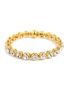 This bracelet is a classic—and one of our must-have obsessions. With its yellow gold hardware and spectacular set of oversized faceted gems, this is all you need to up your glam factor in a instant.
