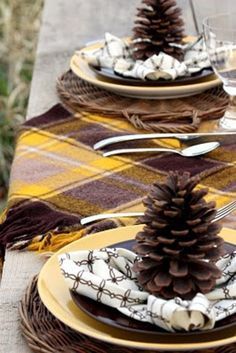 Autumn Tablescape with yellow and brown plad table scafr.  Love the wicker charger plates and the pinecone on top.
