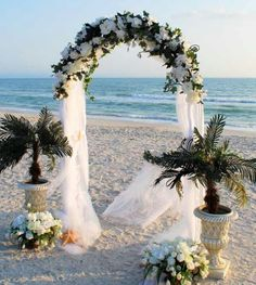 Wedding arch with roses and sheer mesh