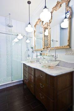 Large gold mirror above vanity sink - in a pretty modern bathroom. Brooklyn DIY Designs